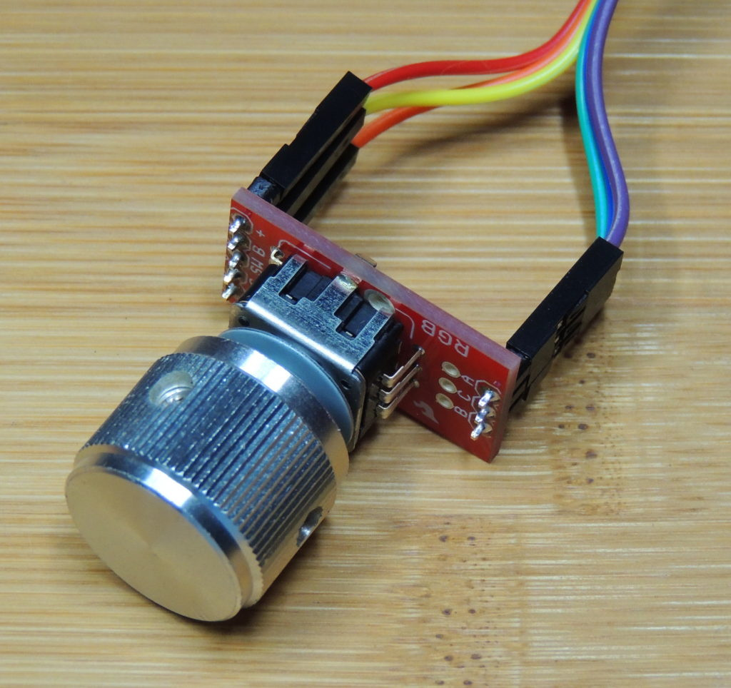 RGB LED rotary encoder with push button, mounted on a Sparkfun breakout board