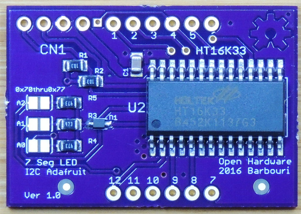 Surface mount components and HT16K33 chip soldered to board