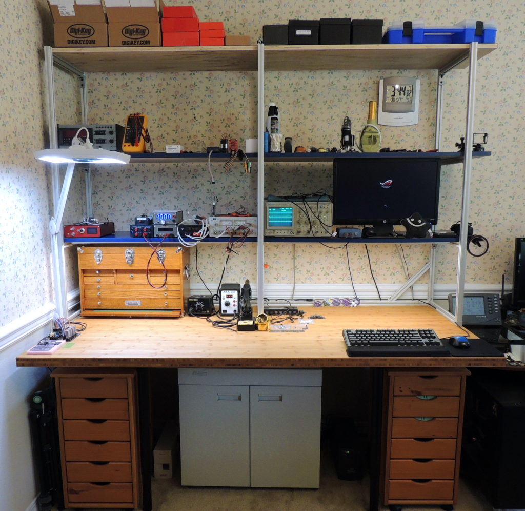 Completed electronics workbench build with shelves and lighting installed