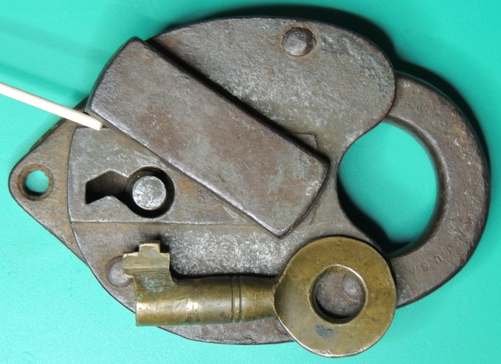 J.H.W. CLIMAX Co Steel Padlock front showing keyway and brass key